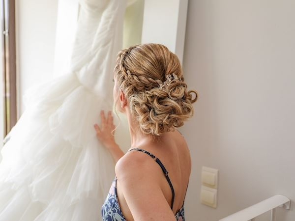 wedding hairstyle trend braided crown Velas Weddings